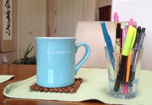 cup and pens